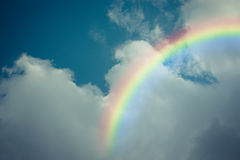 Blue sky cloud with rainbow , process in vintage style Stock Image