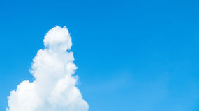 Blue Sky with Cloud in the Snowman Like Shape at The Corner with Copy Space used as Template Stock Image