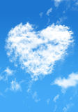 Blue sky with cloud style heart Stock Image