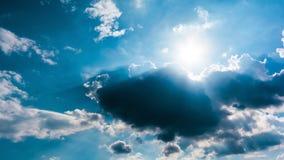 Blue sky and cloud with sunbeam Stock Photos