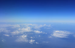 Blue sky and Cloud Top view from airplane window Stock Photography