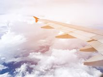 Blue sky and cloud view through flying Airplane window Royalty Free Stock Photography