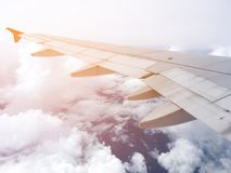 Blue sky and cloud view through flying Airplane window Royalty Free Stock Photo