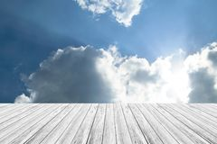 Blue sky cloud with Wood terrace. Nature cloudscape with blue sky and white cloud with Wood terrace Royalty Free Stock Image