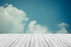 Blue sky cloud with Wood terrace , process in vintage style Stock Image