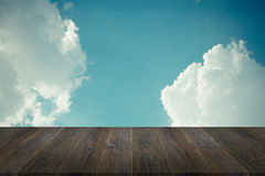 Blue sky cloud with Wood terrace , process in vintage style Stock Photo