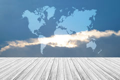 Blue sky cloud with Wood terrace and world map. Nature cloudscape with blue sky and white cloud with Wood terrace and world map Royalty Free Stock Photos