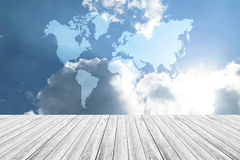 Blue sky cloud with Wood terrace and world map. Nature cloudscape with blue sky and white cloud with Wood terrace and world map Royalty Free Stock Photography