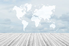 Blue sky cloud with Wood terrace and world map Royalty Free Stock Photography