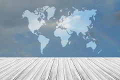 Blue sky cloud with Wood terrace and world map Royalty Free Stock Photo