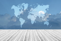 Blue sky cloud with Wood terrace and world map Royalty Free Stock Images