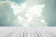 Blue sky cloud with Wood terrace and world map , process in vint Royalty Free Stock Photos