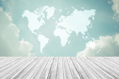 Blue sky cloud with Wood terrace and world map , process in vint Royalty Free Stock Image