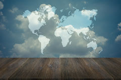 Blue sky cloud with Wood terrace and world map , process in vint Royalty Free Stock Images