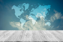 Blue sky cloud with Wood terrace and world map , process in vint Royalty Free Stock Photo