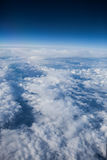 Blue sky with cloudes. View of clouds through an airplane window royalty free stock photography