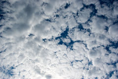 Blue sky and clouds. Illuminated by bright sun Stock Photography