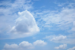 Blue sky clouds. White puffy clouds floating on blue sky Royalty Free Stock Image