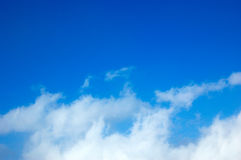 Blue sky and clouds. White clouds against the blue sky stock image