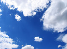 Blue sky and clouds. Some white clouds in the blue sky Stock Image