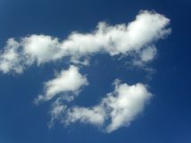 Blue sky with clouds. Dark and bright blue sky with white clouds Royalty Free Stock Photography