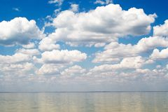 The blue sky and clouds. Over a bay Royalty Free Stock Photography