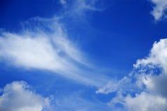 Blue sky with clouds. The Blue sky with clouds Stock Photo