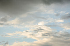 Blue sky with clouds. Gray clouds on blue sky after a rainy hours Stock Photography