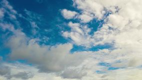 Blue sky with clouds, aerial landscape Time lapse . Time lapse: Blue sky and white fluffy clouds, aerial view. Summer and travel vacation concept stock footage
