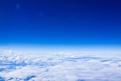 Blue sky with clouds through the aircraft windows Royalty Free Stock Photo