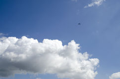 Blue sky clouds and airplane Royalty Free Stock Photo