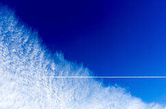 Blue sky clouds airplane Royalty Free Stock Photography