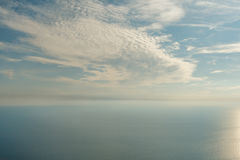 Blue sky with clouds and airplane trails over the Black sea. Nature composition. Stock Image