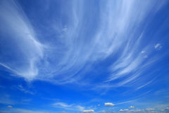 Blue sky with clouds. As a background Stock Images