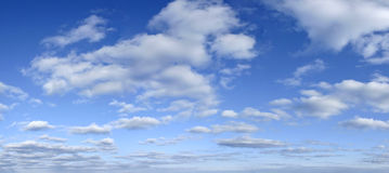 Blue sky with clouds backdrop - early afternoon royalty free stock image