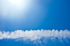 Blue sky with clouds background. Royalty Free Stock Photo