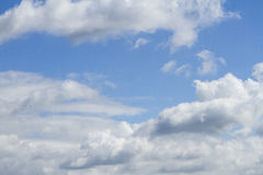 Blue sky with clouds. Background Stock Photography