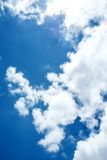 Blue sky and clouds background stock images
