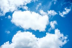 Blue sky and clouds background stock image