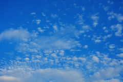 Blue sky with clouds. Background Stock Images