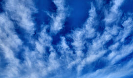 Blue sky with clouds background. HDR image Royalty Free Stock Photos