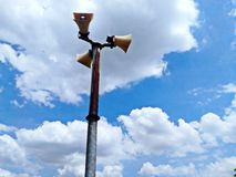 Blue sky clouds background and loudspeaker tower. Stock Photography