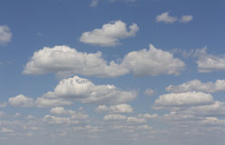 Blue sky with clouds background photo Royalty Free Stock Photo