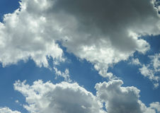 Blue sky with clouds background Royalty Free Stock Photos