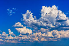 Blue sky with clouds. Blue sky background with white clouds Royalty Free Stock Photo