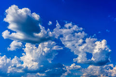 Blue sky with clouds. Blue sky background with white clouds royalty free stock images