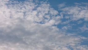 Blue sky and clouds. Beautiful piling up clouds on a blue calm sky. Static shiot. stock footage