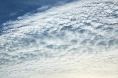 The blue sky with clouds. Background stock photo