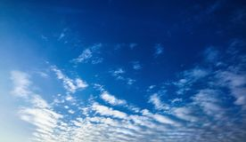 The blue sky with clouds. Vivid background stock photos