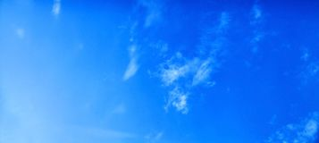 The blue sky with clouds. Vivid background royalty free stock photo